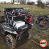 A close up of a UTV rack with Spare tire mounted to tailgate