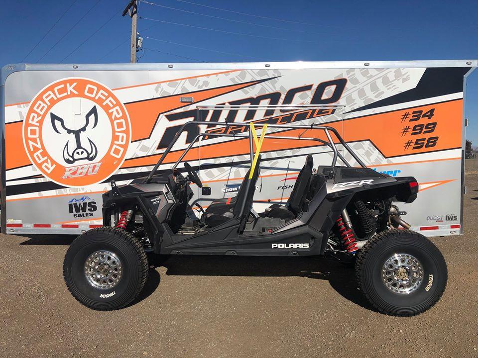 Custom roll cage on Polaris RZR XP turbo S with Rimco Racing trailer