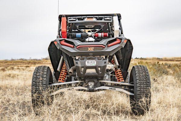 Cargo Rack and Painted Suspension Tensor Tires for Polaris RZR Turbo S Custom UTV SEMA Build
