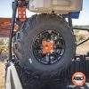 A close up of a UTV rack with Spare tire mounted