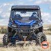 UTV sitting on top of a dry grass field