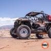 Side of UTV parked in rocky desert
