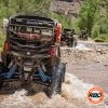 UTVs driving through a riverbed