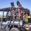 ATV driving down a dirt road