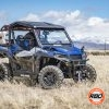 Side of UTV on top of a dry grass field