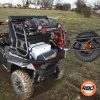 UTV filled with gear on muddy grass