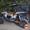 Side view of UTV by trees