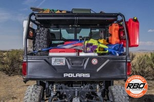 Bed of UTV filled with luggage