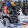 UTV with bed full parked in snow