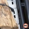 Lumber attached to cargo rack with a bungee cord