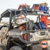 UTV filled with gear in front of dry grass