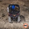 A pile of luggage sitting on top of a UTV