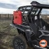 A UTV that is sitting in the grass
