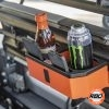 Energy drink and tea in a UTV console with cellphones