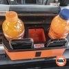 Orange juice in drink console with phones