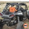 UTV parked on the side of a dirt field